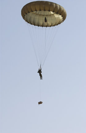 A paratrooper serving with 1st Battalion, The Parachute Regiment on a practice jump in Kuwait, during preparations for Operation 'TELIC', the invasion of Iraq, 16 March 2003.