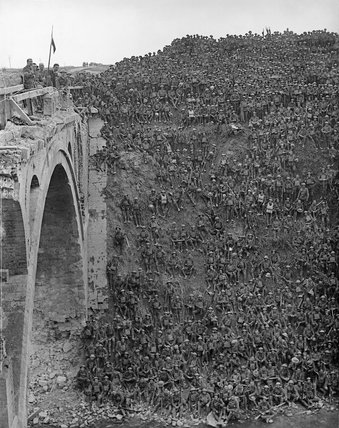 Men of 137th Brigade, 46th Division, are addressed by Brigadier General J C Campbell VC CMG DSO on the Riqueval Bridge after breaking the German's Hindenburg Line defences on 29 September 1918.