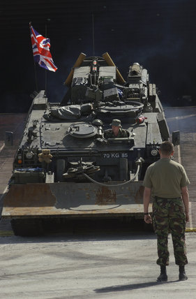 A Royal Electrical and Mechanical Engineers Challenger ARV (Armoured Recovery Vehicle) drives off the ship which has brought it to Kuwait from Germany, 23 February 2003.