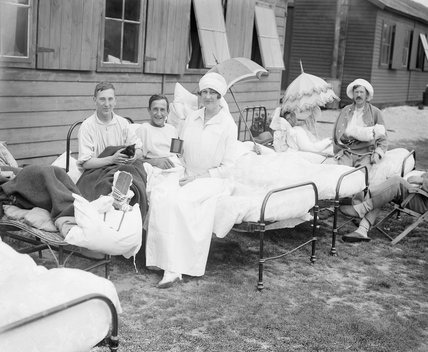 The Duchess of Sutherland sitting with patients at her hospital at Calais during July 1917.