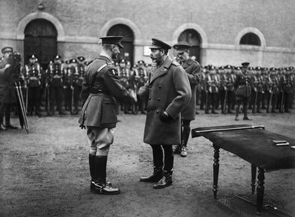Commander Daniel Beak, Drake Battalion, Royal Naval Division, being presented with the Victoria Cross by King George V At Valenciennes on 6 December 1918.