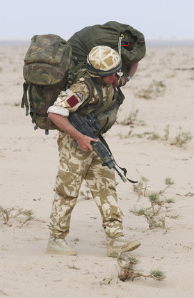 A Paratrooper Serving With 1st Battalion The Parachute Regiment After A Practice Jump In Kuwait During Preparations For Operation Telic The Invasion Of Iraq 16 March 2003 on home design front view