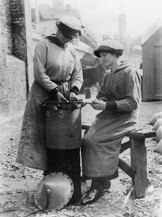Two ratings of the Womens Royal Naval Service (WRNS) assembling a mine at Lowestoft in 1918.