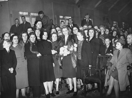 Vera Lynn with munitions workers following a lunchtime concert at a factory, somewhere in Britain during 1941.