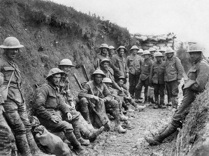 Men of Royal Irish Rifles resting in a communication during the opening hours of the Battle of the Somme, 1 July 1916.