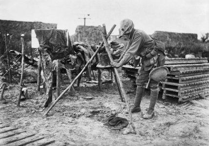 A gas sentry ringing an alarm at Fleurbaix, June 1916.