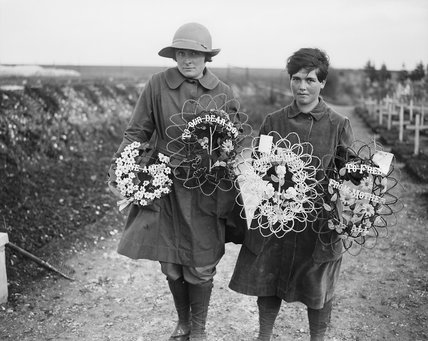 Two members of the Women's Auxiliary Army Corps carrying wreaths to place on the graves of British soldiers buried at Abbeville, 9 February 1918.