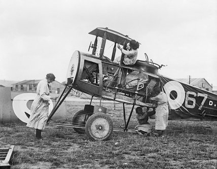 Air Mechanics of the Women's Royal Air Force (WRAF) working on the fuselage of an Avro 504 aircraft during early 1919.