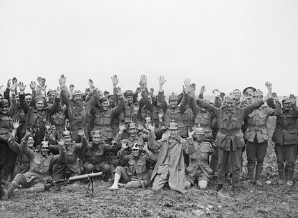 Men of the 1st Anzac Division, some wearing German Helmets, pose for the camera after fighting near Pozieres on 23 July 1916 during the Battle of the Somme.