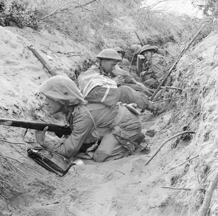 Men of 'D' Company, 1st Battalion, The Green Howards occupy a captured German communications trench during the offensive at Anzio, Italy, 22 May 1944.