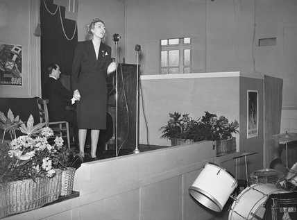 Vera Lynn sings to workers during their lunch break at a factory in the south of England during the Second World War.