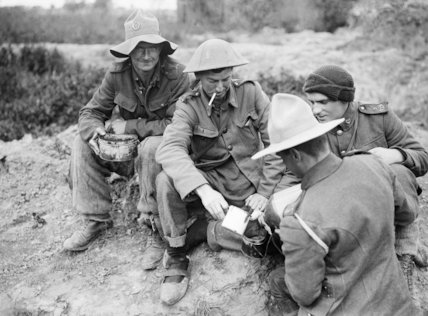 New Zealand troops of the 9th (Wellington East Coast Rifles) Regiment being issued with their rum ration at Fleaurbaix, June 1916.