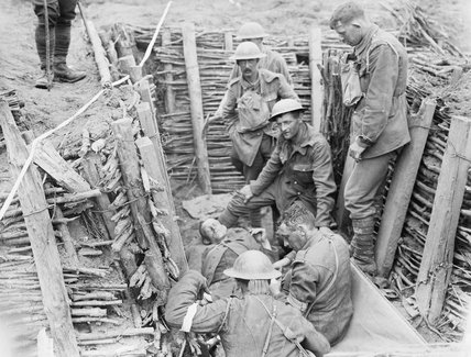 Irish Guardsmen attending to a wounded German during the Battle of Pilckem Ridge on 31st July 1917.