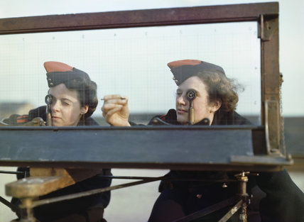 Auxiliary Territorial Service (ATS) girls at the Royal Artillery Experimental Unit, at Shoeburyness in Essex, using the Window Position Finder to sight shell bursts in the air or water, 1943.