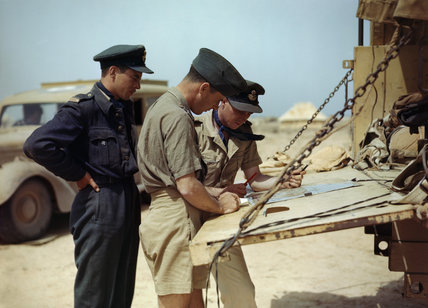 Spitfire pilots of No. 417 Squadron, Royal Canadian Air Force, planning another operation from their airfield at Goubrine in Tunisia, April 1943.