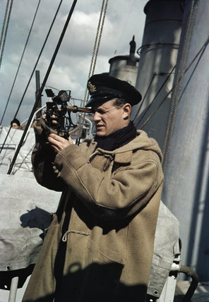 A Royal Navy Officer Using A Sextant Aboard A Destroyer On