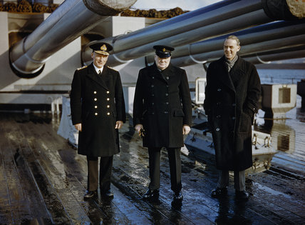 Winston Churchill with the Lord Privy Seal, Sir Stafford Cripps, and the Commander-in-Chief Home Fleet, Admiral Sir John Tovey, on the quarterdeck of HMS KING GEORGE V at Scapa Flow, 11 October 1942.