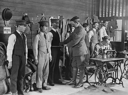New recruits to the British Army are measured for their uniforms during the First World War.