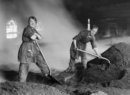 Women war workers feed charcoal kilns used for purifying sugar at a refinery in Scotland during the First World War.