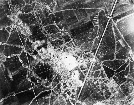Aerial photograph showing front line trenches and mine craters near Loos in 1917.