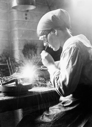 A female acetylene welder at work in an aircraft factory in the Midlands, 1918.