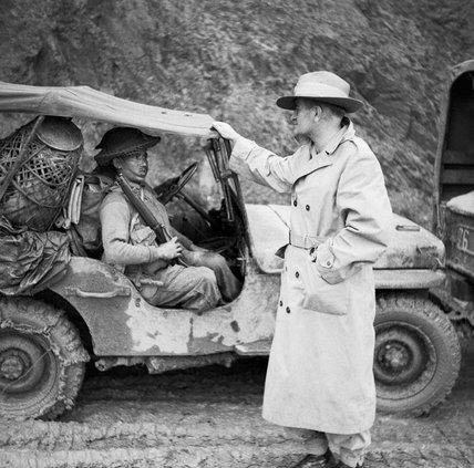 Lieutenant General Sir William Slim, commanding British Fourteenth Army in Burma, chatting with a Gurkha rifleman, November 1944.