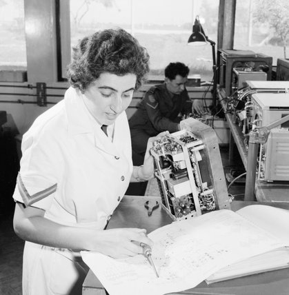 Lance Corporal Frances Crowley of the Women's Royal Army Corps (WRAC) repairs test equipment in the workshop of 48 Command, REME, at Dhekelia, Cyprus, March 1963.