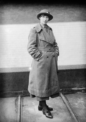 A full-length portrait of a female Army Service Corps driver, wearing winter uniform.