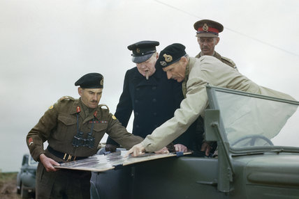 General Sir Bernard Montgomery shows Winston Churchill the battle situation on a map held by the Commander of the 2nd Canadian Division, General G G Symonds, during the Prime Minister's visit to Normandy, 22 July 1944.