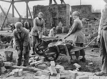 Female Bricklayers At Work On A Building Site In