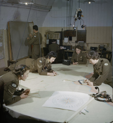 Auxiliary Territorial Service plotters at work at 428 Battery, Coastal Defence Artillery Headquarters, Dover, December 1942.
