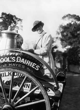A milkwoman standing on her dairy cart in southern England during the First Wotrld War.