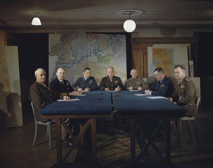 General Dwight D Eisenhower, Supreme Commander of the Allied Expeditionary Force (centre), flanked by his senior commanders, 1 February 1944. Left to right: Lieutenant General Omar Bradley; Admiral Sir Bertram Ramsay; Air Chief Marshal Sir Arthur Tedder;