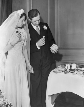 Newly-weds examine American tinned meat, which features as part of their wedding feast held at 'Dr Johnson's House' in Gough Square, London during 1941.