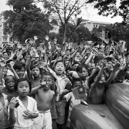 Children cheering the arrival of the 5th Indian Division in Singapore, 5 September 1945.