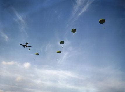 Paratroopers dropping from an Armstrong Whitworth Whitley of No. 295 Squadron at Netheravon, October 1942.