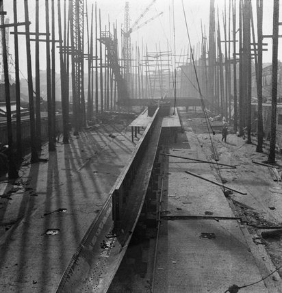 A view of a ship's keel in a slipway. A keel is the principal structural member of a ship, running lengthwise along the centre line from bow to stern, to which the frames are attached.