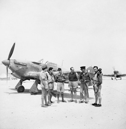 Pilots of No 335 (Hellenic) Squadron RAF in front of a Hawker Hurricane Mark I at LG 20/Qotafiyah I, west of Daba, Egypt.