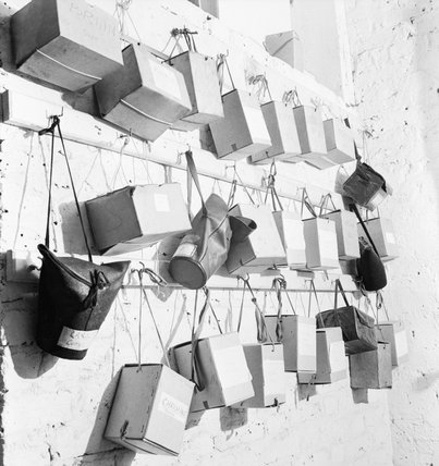 A selection of boxes containing children's gas masks hang in the entrance to the basement air raid shelter of the 'Foster Parents Plan for War Children' nursery, in Hampstead.