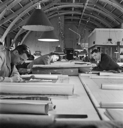A general view of the Drawing Office at a shipyard, somewhere in Britain, showing men at work on various ships' plans