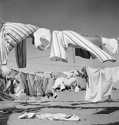 The Western Desert 1942: Lines of washing strung across the desert sand.