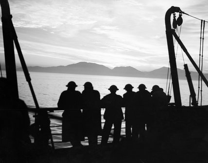 British troops on board a troop ship watching the sunset off the Norwegian coast, as Allied contingents began landing to counter the German invasion, 20 April 1940.