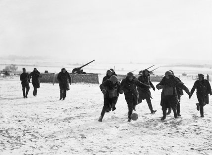A game of football being played in the snow at 1st Anti Aircraft Brigade Headquarters at Avesnes Le Comte.