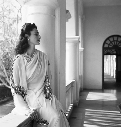 Political Personalities: Three quarter length portrait of Princess Durri Shehvar Berar, only daughter of the former Sultan of Turkey, photographed wearing a jewelled sari in India.