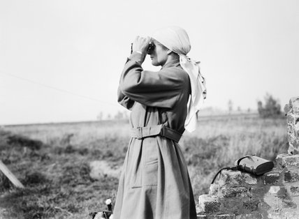 Miss Mairi Chisholm, one of the 'Women of Pervyse' looking through binoculars in Pervyse.
