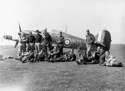 Pilots of No. 33 Squadron RAF, at Larissa, Greece, with Hawker Hurricane Mark I, V7419, in background.