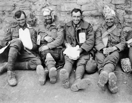 A portrait of four smiling Canadians, as they await treatment at a Casualty Clearing Station, Duisans, 3 September 1918.
