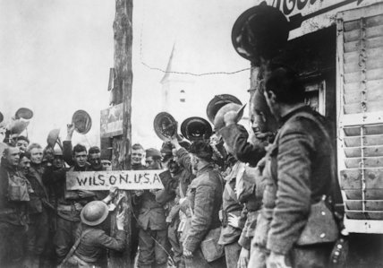 American troops change a German street sign in a town in the St Mihiel salient on the Western Front in 1917. 'Hindenberg Strasse' is renamed 'Wilson USA'.