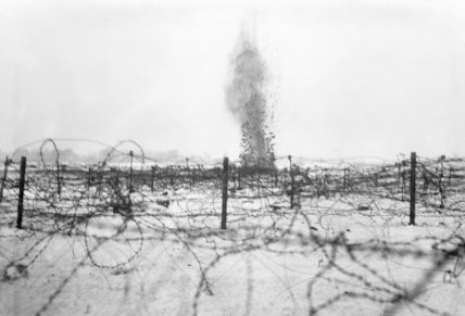 A shell bursting amongst the barbed wire entanglements on the battlefield at Beaumont Hamel, December 1916.