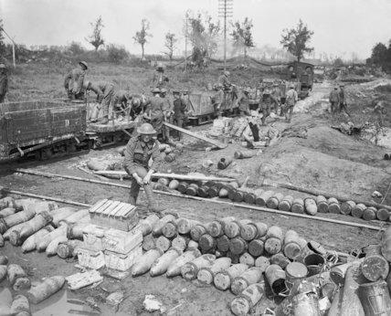 Gunners of the Royal Garrison Artillery unloading shells, Brielen, 3 August 1917.